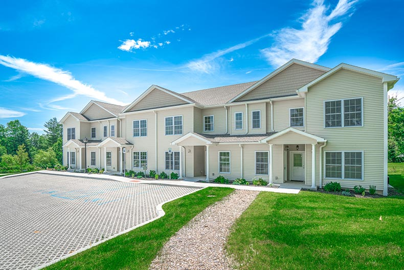 A blue sky over a row of attached homed at Villas At Seminary Hill in Carmel, New York