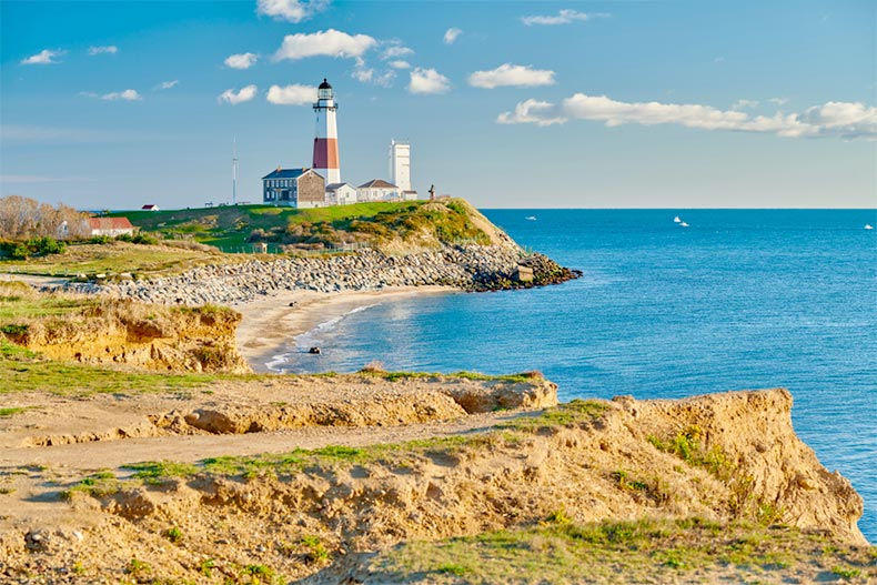 Blue sky over the Montauk Lighthouse and shoreline on Long Island