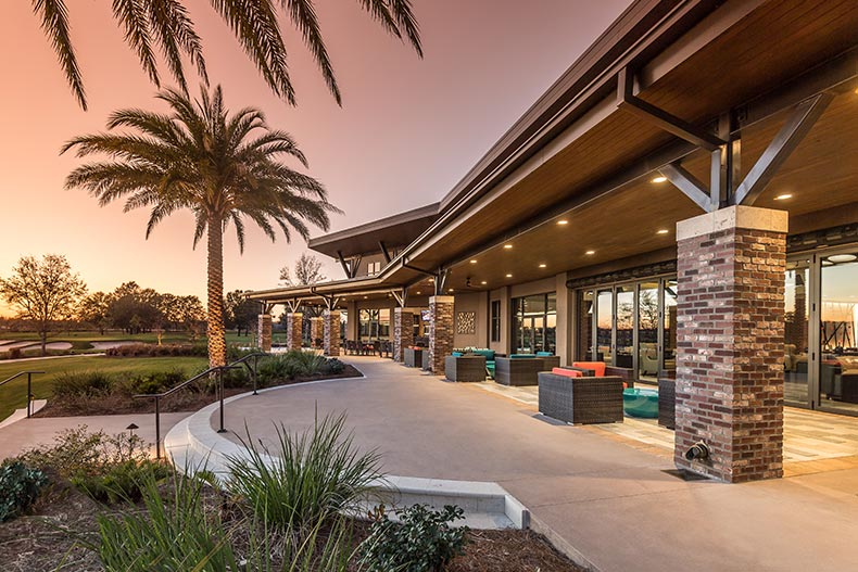 Sunset view of the outdoor patio at Trilogy at Ocala Preserve in Ocala, Florida