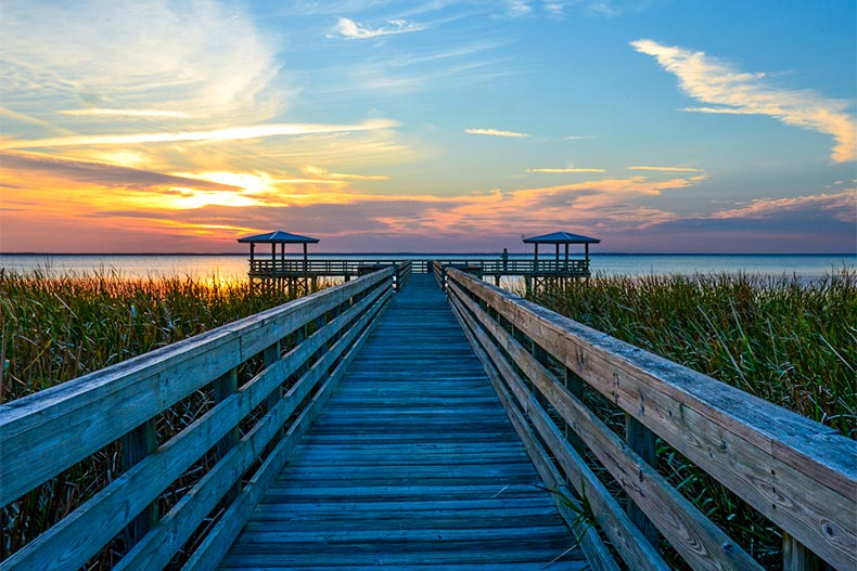 View of a sunset from a wooden pier in Ocala, Florida