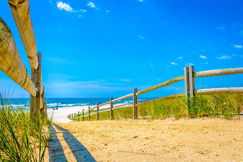 Walkway onto Ocean County, New Jersey beach with ocean in background.