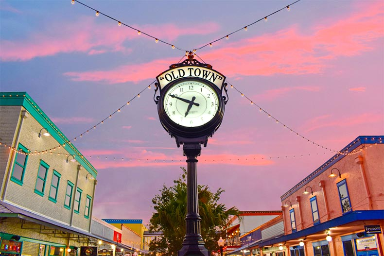 Clock with sunset in Old Town Orlando, Florida