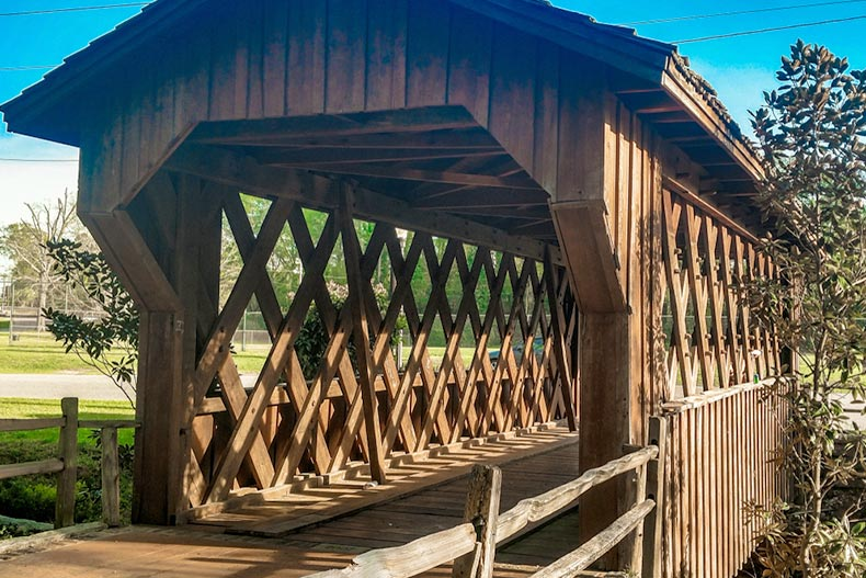 A wooden covered bridge at Municipal Park in Opelika, Alabama