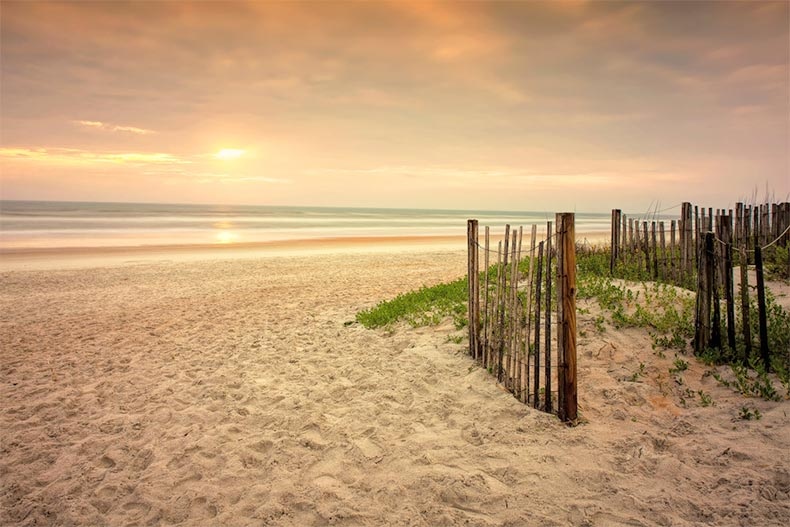A wooden fence along the shore of Ormond Beach in Florida