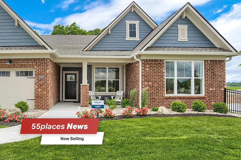 """55places News: Now Selling"" banner over a model home at  Osborne Trails in Westfield, Indiana"