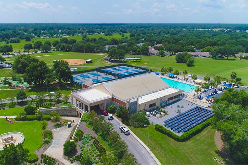 Aerial view of On Top of the World recreation center with pool and pickleball courts