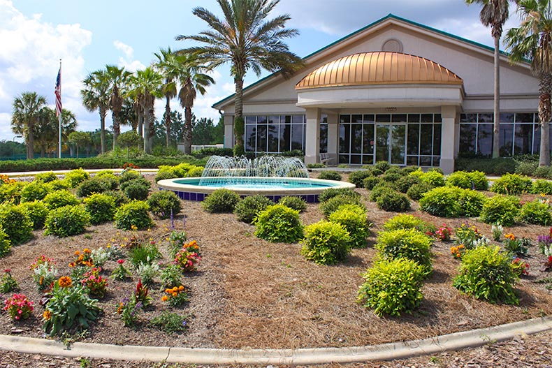 Landscaping and fountain in front of On Top of the World clubhouse in Florida