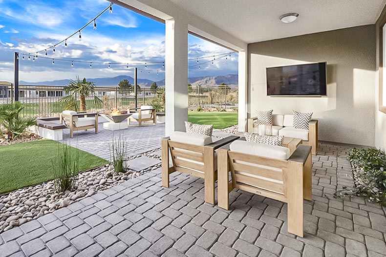 The outdoor patio and fireplace at Ovation at Mountain Falls in Pahrump, Nevada