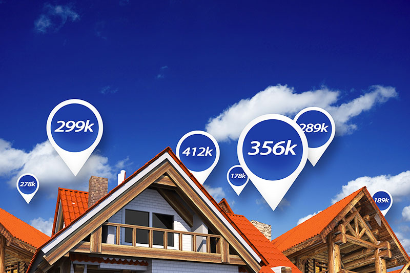 Tops of houses with blue sky and different price tags attached to each.