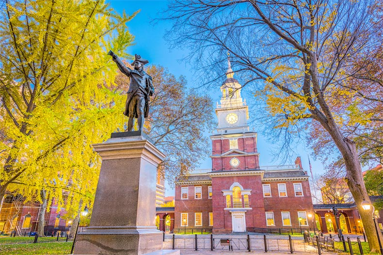 View of the statue outside Independence Hall in Philadelphia, Pennsylvania at sunset