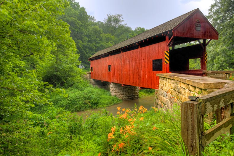 View of the Longdon Covered Bridge in Pennsylvania surrounded by greenery in bloom