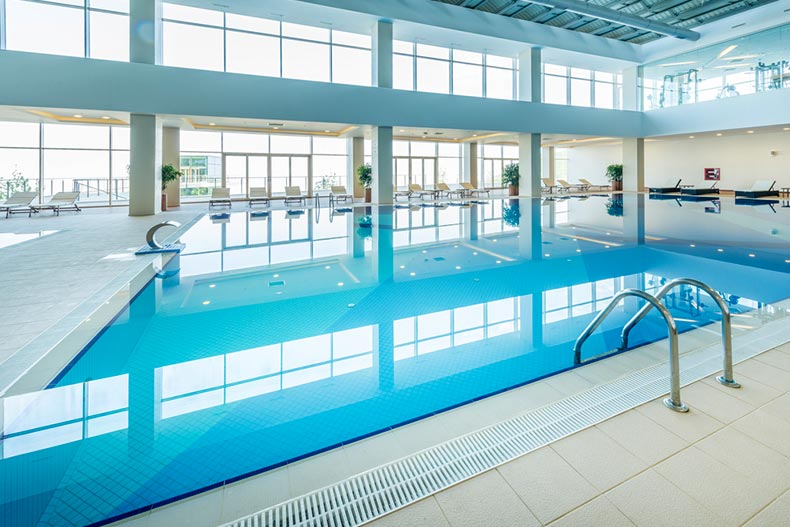 Interior view of an indoor pool at a fitness center