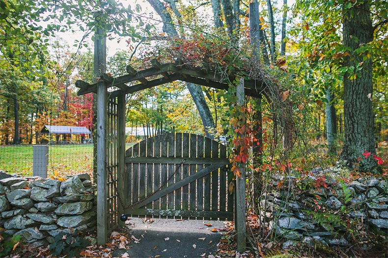 View of the wooden archway and gated entrance to Kings Gap Environmental Education Center in Carlisle, Pennsylvania