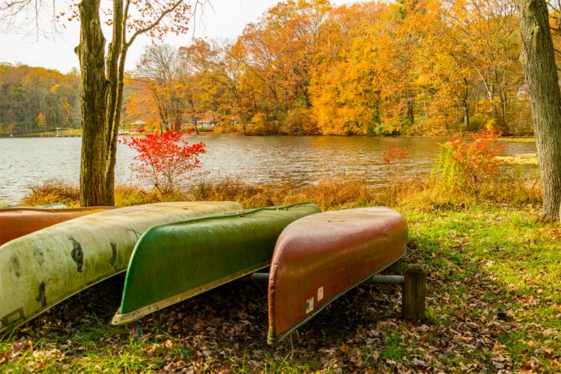 View of canoes at the edge of a scenic lake in mid-autumn in Lebanon County, Pennsylvania
