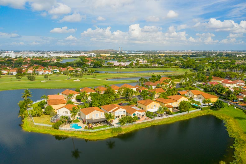 An aerial view of houses lining a lake in Pembroke Pines, Florida