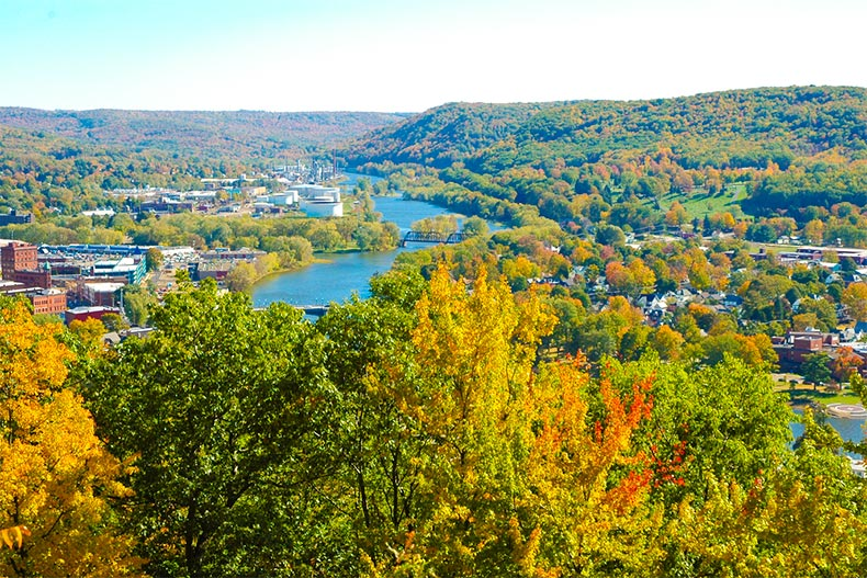 Aerial view of Allegheny River and Warren, PA with fall foliage