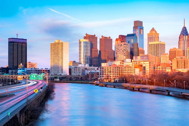 View over the Schuylkill River of the Philadelphia skyline in an orange sunset light