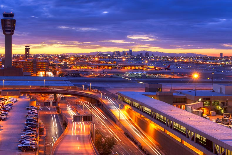 The Phoenix airport at sunset with light trails in the street