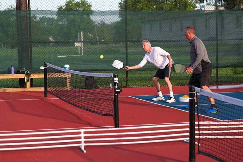 Two men playing pickleball