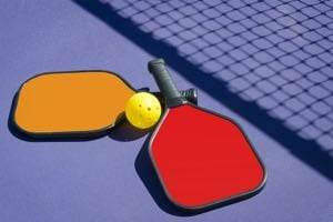 Paddles and a plastic ball are the main equipment necessities.