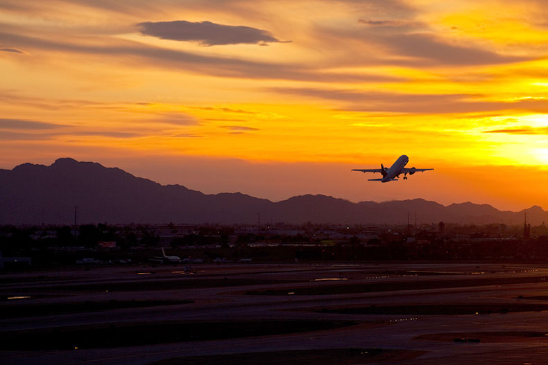 A plane taking off at sunset at Phoenix Sky Harbor International Airport in Phoenix, Arizona.