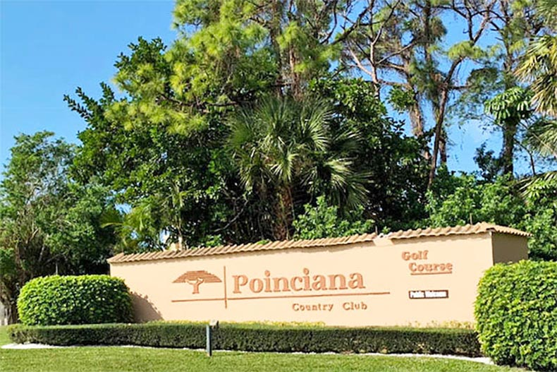 Greenery surrounding the community sign for Poinciana in Lake Worth, Florida