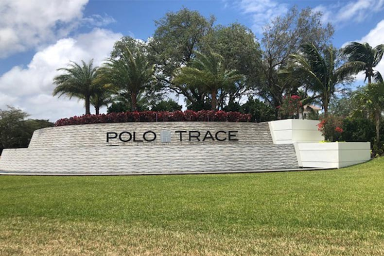 Palm trees surrounding the community sign for Polo Trace in Delray Beach, Florida