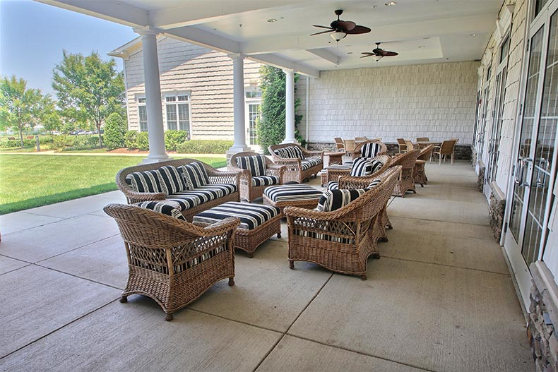 Lounge chairs on the patio outside the clubhouse at Potomac Green in Ashburn, Virginia