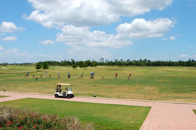 Golfers can warm up before a round at the practice driving range or putting green.