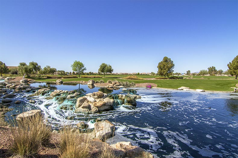 A picturesque stream flowing beside the golf course at Province in Maricopa, Arizona