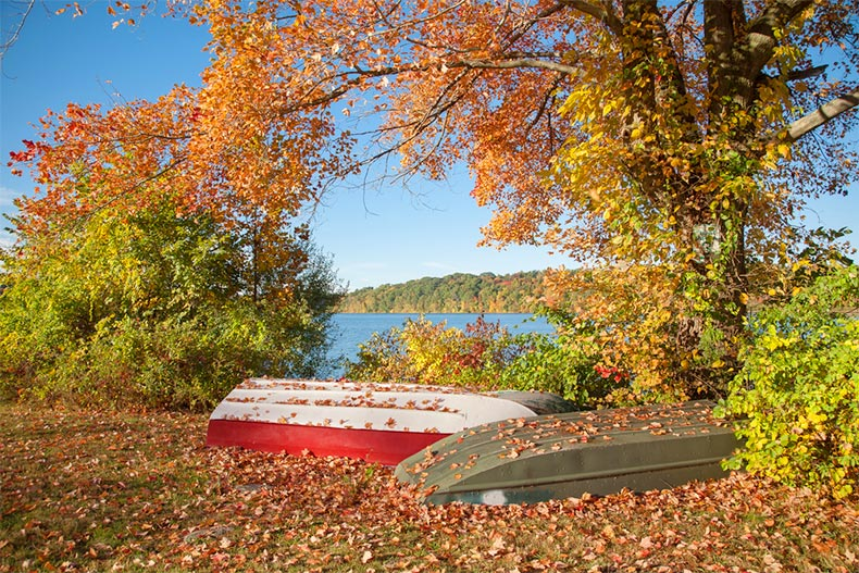 Two unused row boats next to the lake in Putnam County, New York