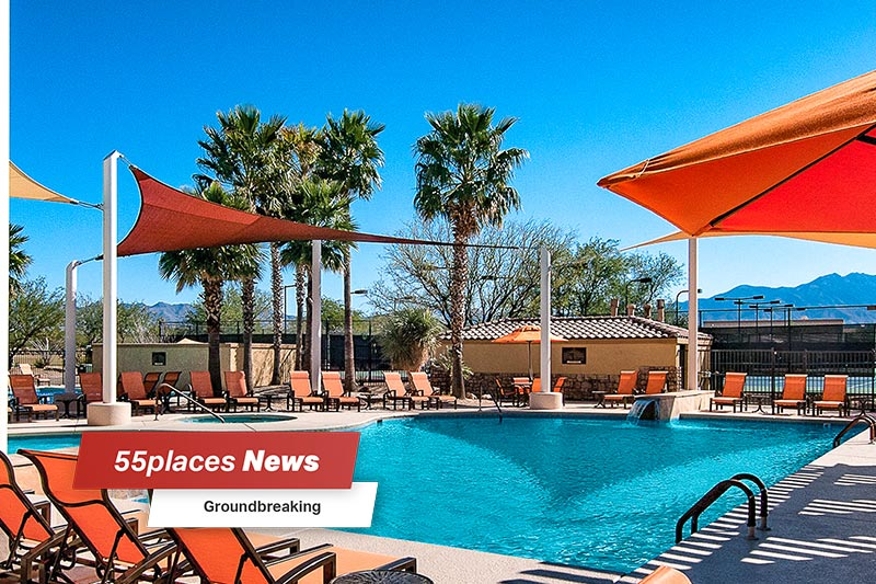 """Groundbreaking"" banner over an outdoor pool and patio at Quail Creek in Green Valley, Arizona"