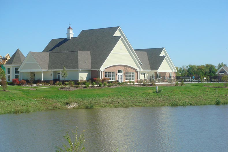 View across a pond of the clubhouse at Regency at Bowes Creek Country Club in Elgin, Illinois