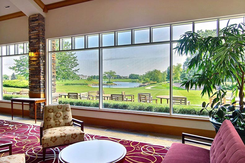 View of a golf course through the window of a lounging area in Sun City Huntley in Huntley, Illinois