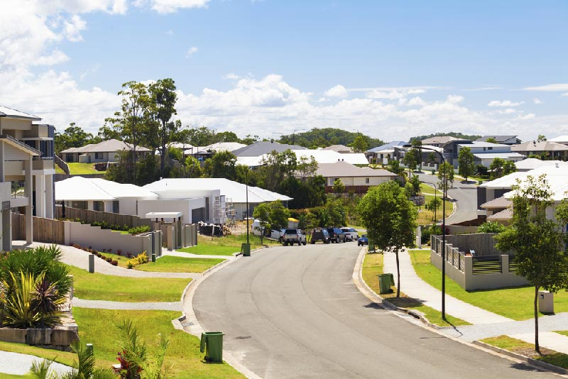 residential community with many homes and green lawns