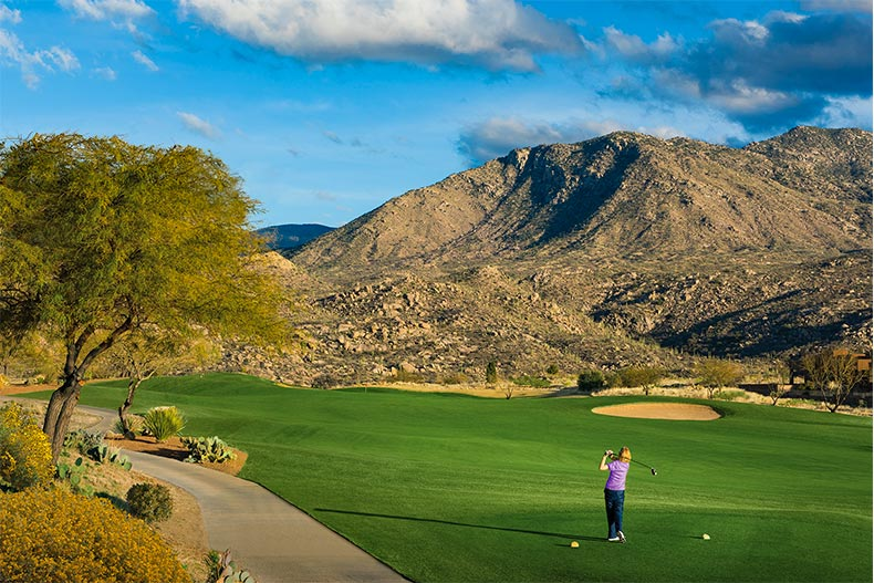 View of the community golf course with mountains in the background at SaddleBrooke in Tucson, Arizona