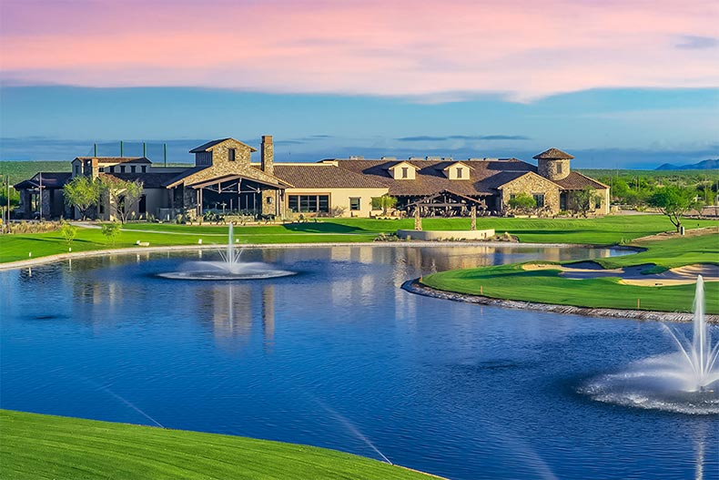 Fountains in a pond beside the golf course and clubhouse at SaddleBrooke Ranch in Oracle, Arizona