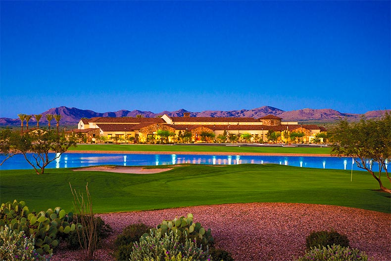Dusk view of SaddleBrooke Ranch clubhouse with scenic mountains behind it