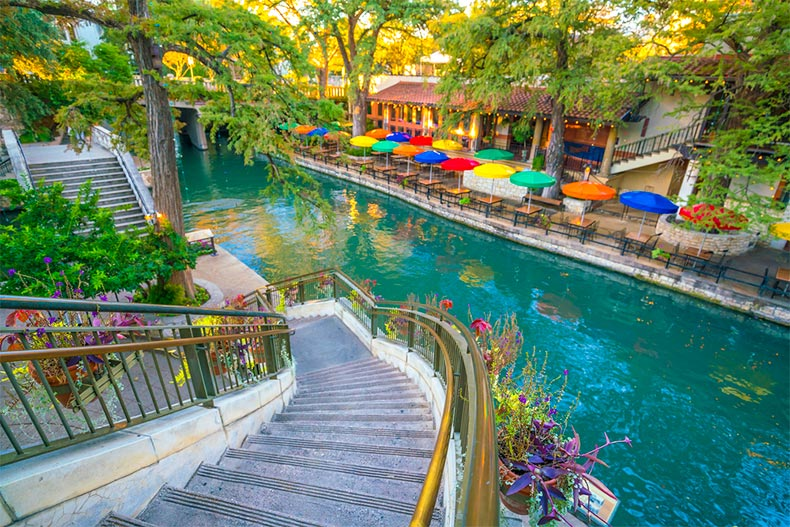 Steps leading down to colorful San Antonio Riverwalk