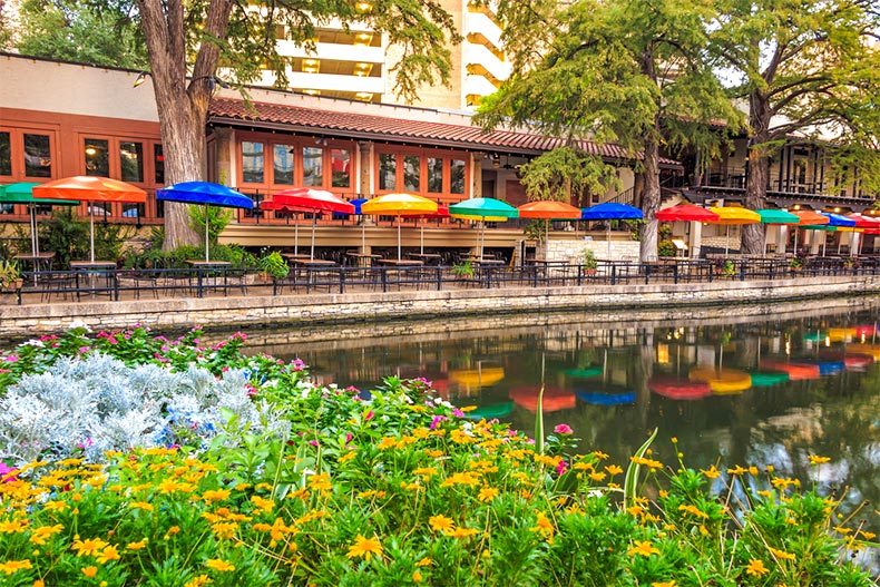 San Antonio's Riverwalk with restaurants and outdoor seating.