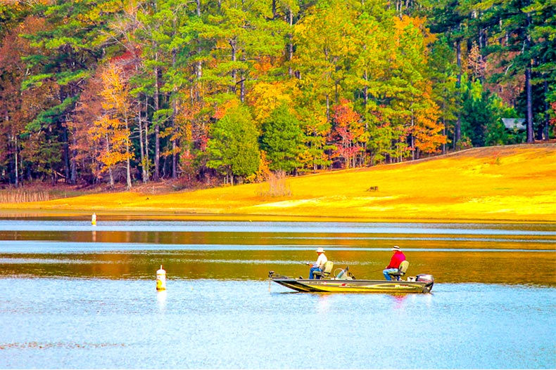 Two fisherman on a boat during autumn in Savannah Lakes Village