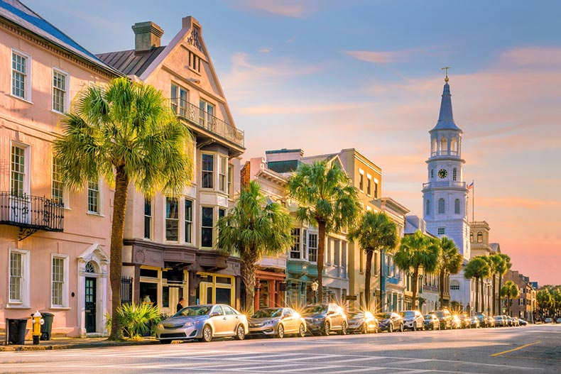 Palm trees lining the street in the historic downtown area of Charleston, South Carolina at sunset