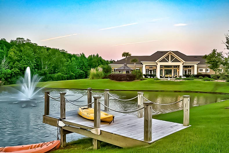 View of a pond with a dock and kayaks at Sun City Hilton Head in Bluffton, South Carolina