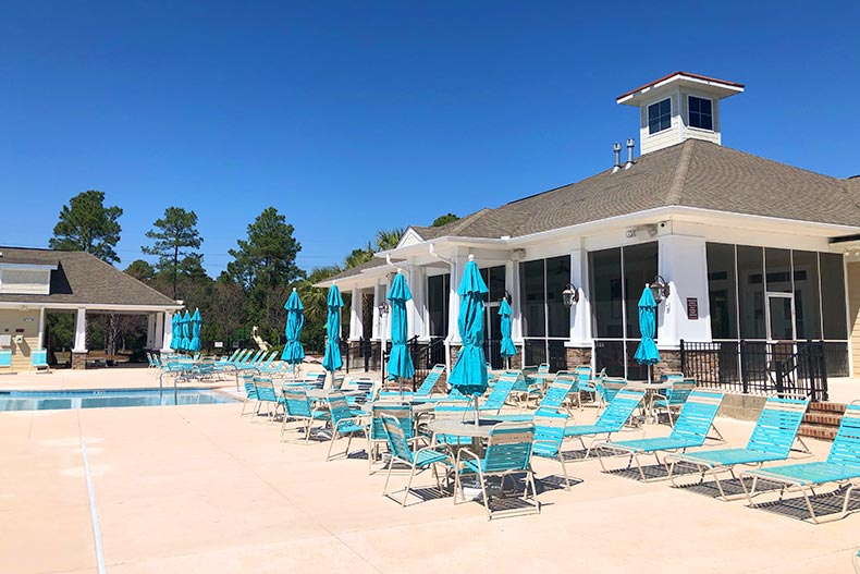 Tables and beach chairs on the outdoor patio near the pool at Berkshire Forest in Myrtle Beach, South Carolina