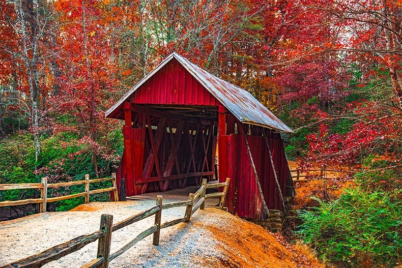 Autumn foliage surrounding the historic Campbells Covered Bridge in Landrum near Greenville, South Carolina