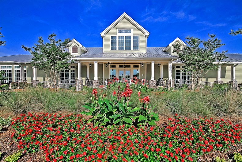 Red flowers in bloom outside the clubhouse at Cresswind Charleston in Summerville, South Carolina
