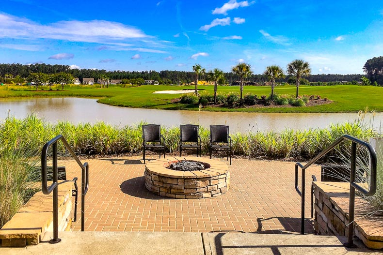 View of the outdoor patio overlooking a pond and a golf course at Sun City Hilton Head in Bluffton, South Carolina