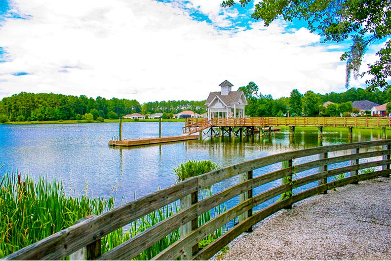 Boathouse and dock on the shores of a pond in Sun City Hilton Head