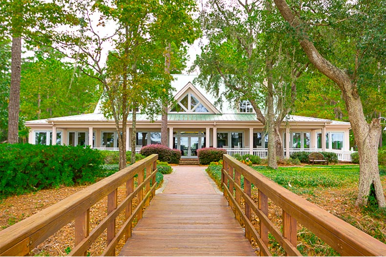 Wooden walkway to clubhouse in Sun City Hilton Head