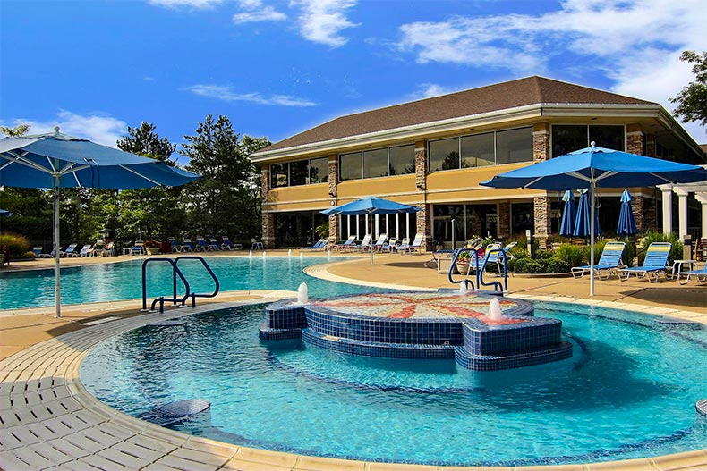 The outdoor pool, patio, and spa at Sun City Huntley in Huntley, Illinois
